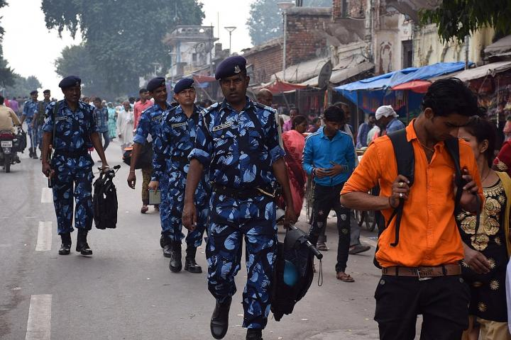 Rapid Action Force personnel patrol a street in Ayodhya. PHOTO: AFP