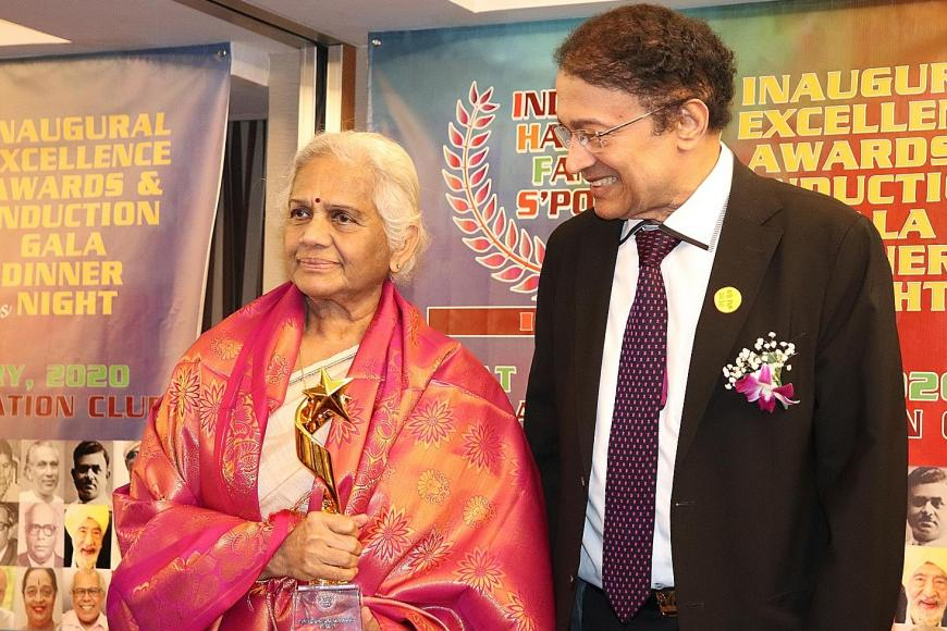 Dancer Santha Bhaskar receiving the excellence award on behalf of her late husband, classical dance pioneer K.P. Bhaskar, from Dr V.P. Nair; (right) entrepreneur Ameerali Jumabhoy making a speech after receiving his award. PHOTOS: INDIANS HALL OF FAME SINGAPORE