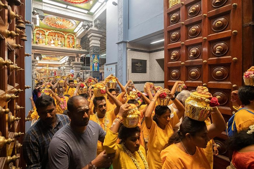 Devotees leaving Sri Srinivasa Perumal Temple at Serangoon Road to start their journey and (right) arrivals at the Sri Thendayuthapani temple at Tank Road. PHOTOS: T. KAVI